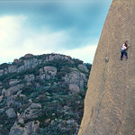 Malcolm Matheson on his spectacular arete of Shifting Sands (28). The Cathedral, Mt Buffalo, Victoria, Australia
