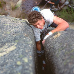 Simon Mentz committed to the nasty off-width of Cacaphonic Crack (21). Mt Buffalo, Victoria, Australia.