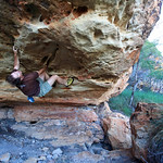 Glenn Tempest on the first ascent of Dunnart (V3), a weird pocketed traverse across a very steep sandstone wall. Keep River National Park, Northern Territory. Photo Karen Tempest.