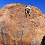 Glenn Tempest on Devils Crack (18), the Devils Marbles. Central Australia.